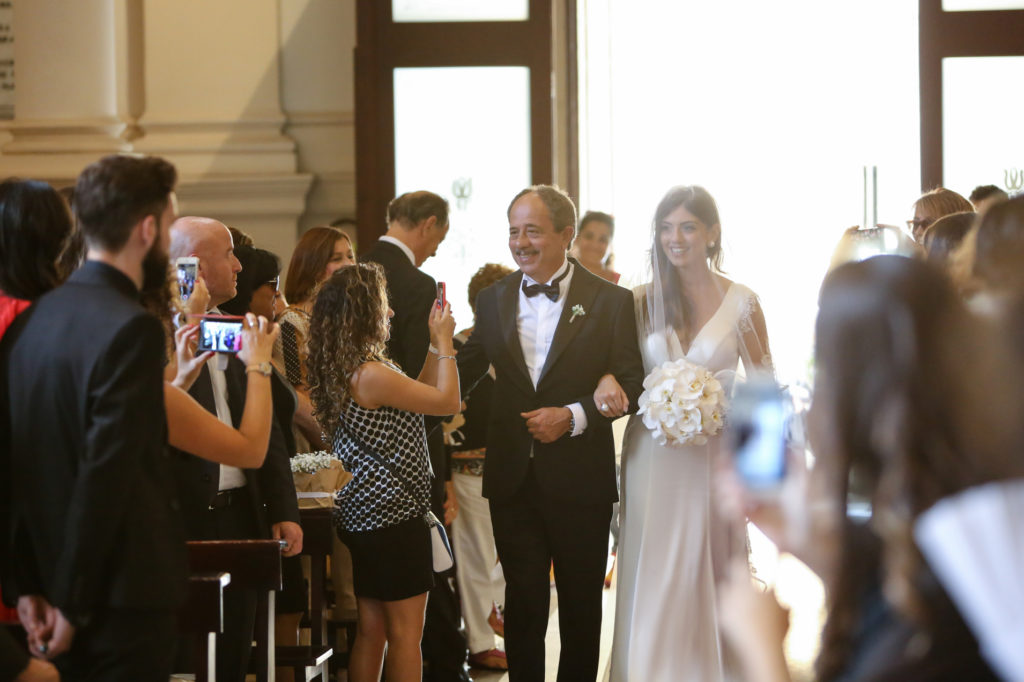 the bride and her father arrive at the church