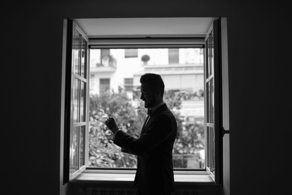groom's portrait at the window